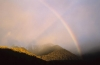 Rainbow and anti crepuscular rays over mountains near Franz Josef New Zealand