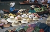 Hat sellers at floating market in Thailand Asia