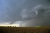 Wedge tornado at rear of shot with funnel cloud in foreground - Kansas USA