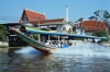 Longtail boat carries tourists on canals in Bangkok Thailand
