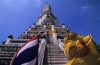 Flags fly at Wat Arun Bangkok Thailand  over the stairs on the central prang