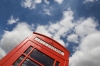 A red telephone box and blue skies