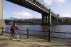 D22319 - A man cycles under the rail Bridge overthe River Tyne