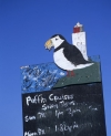 Quaint hand painted sign for Puffin Cruises boat trips, in Amble Harbour, Northumberland, England
