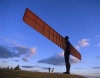 A family walks under the Angel of the North in Gateshead