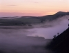 Mist rises from Crag Lough on Hadrians Wall