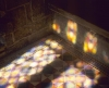 Tiled floor lit by light from a stained glass window in the chapel at  Tynemouth Priory, Tyne & Wear, England