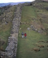 Walking at on the National Trail at Walltown Crags alongside , Hadrians Wall, Northumberland, England