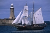 A tall ship passes Tynemouth Pier Lighthouse as it enters the River Tyne during the 2005 Tall Ships race. Tyne & Wear