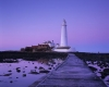 St Marys Lighthouse on Bait Island, Whitley Bay on North Tyneside, Tyne & Wear. England. Showing the causeway which is covered by incoming tides